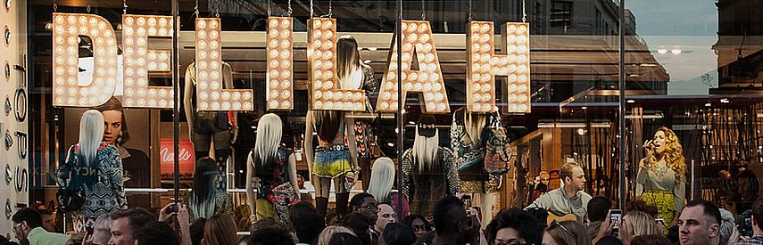 Live Music Event in TOPSHOP, London. Storefront window display becomes a concert venue